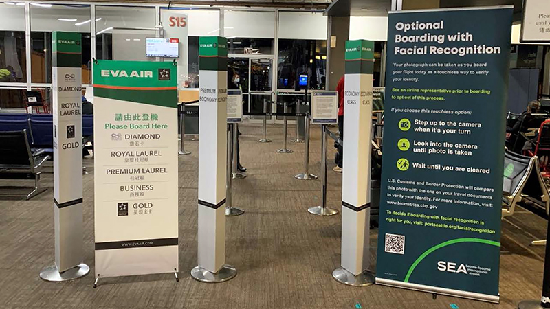 EVA passengers see an alert about optional facial recognition application boarding their flights at SEA Airport July 2021